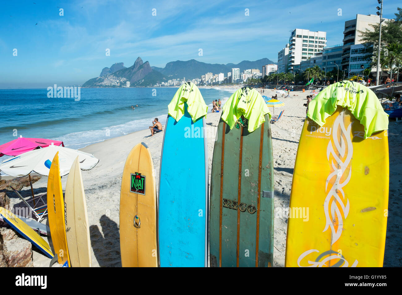 RIO DE JANEIRO - MARCH 30, 2016: Colorful surfboards stand lined up on the beach at Arpoador, a popular surf destination. - Stock Image