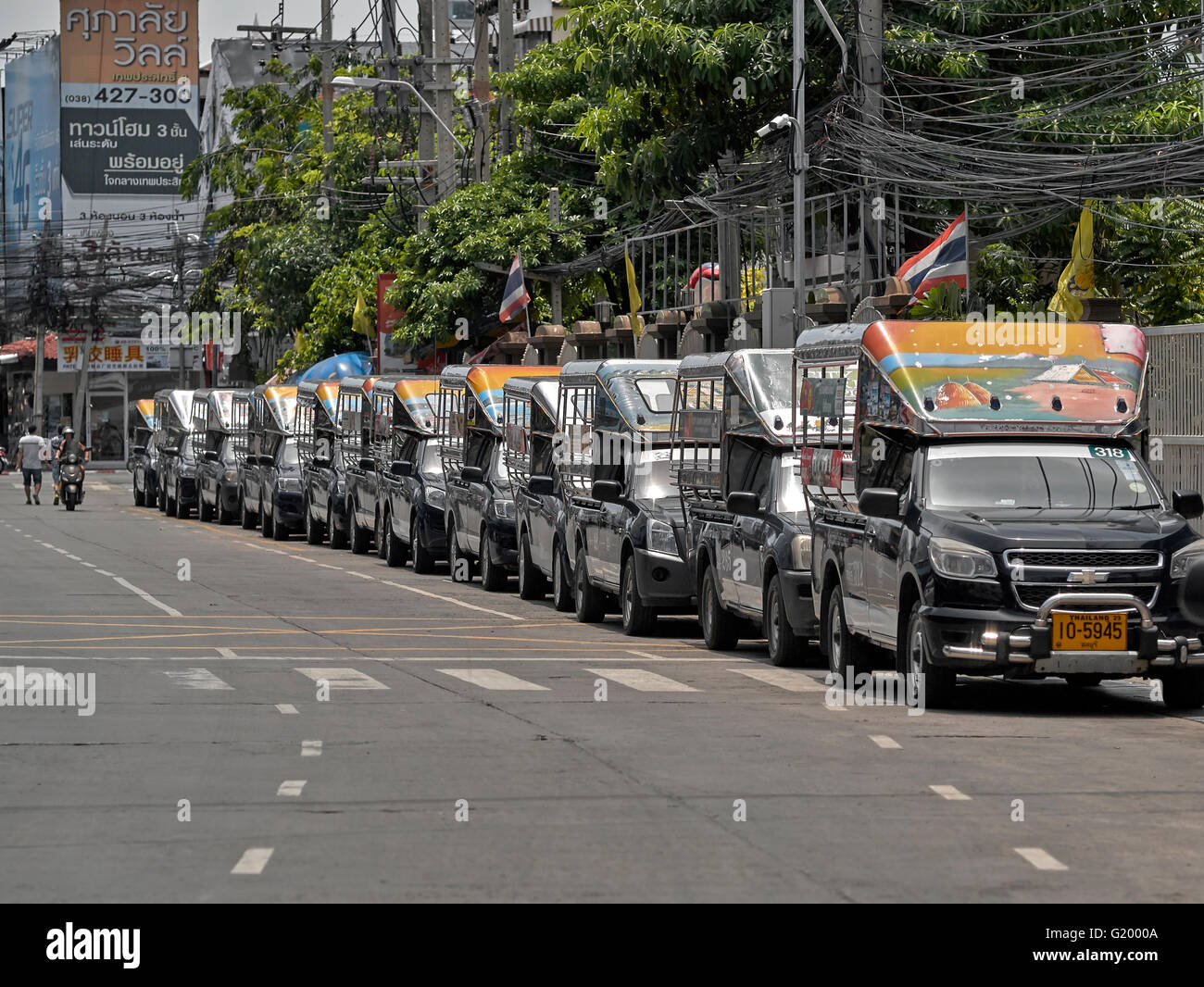 Line of Thai songthaew taxi vehicles. Thailand S. E. Asia - Stock Image