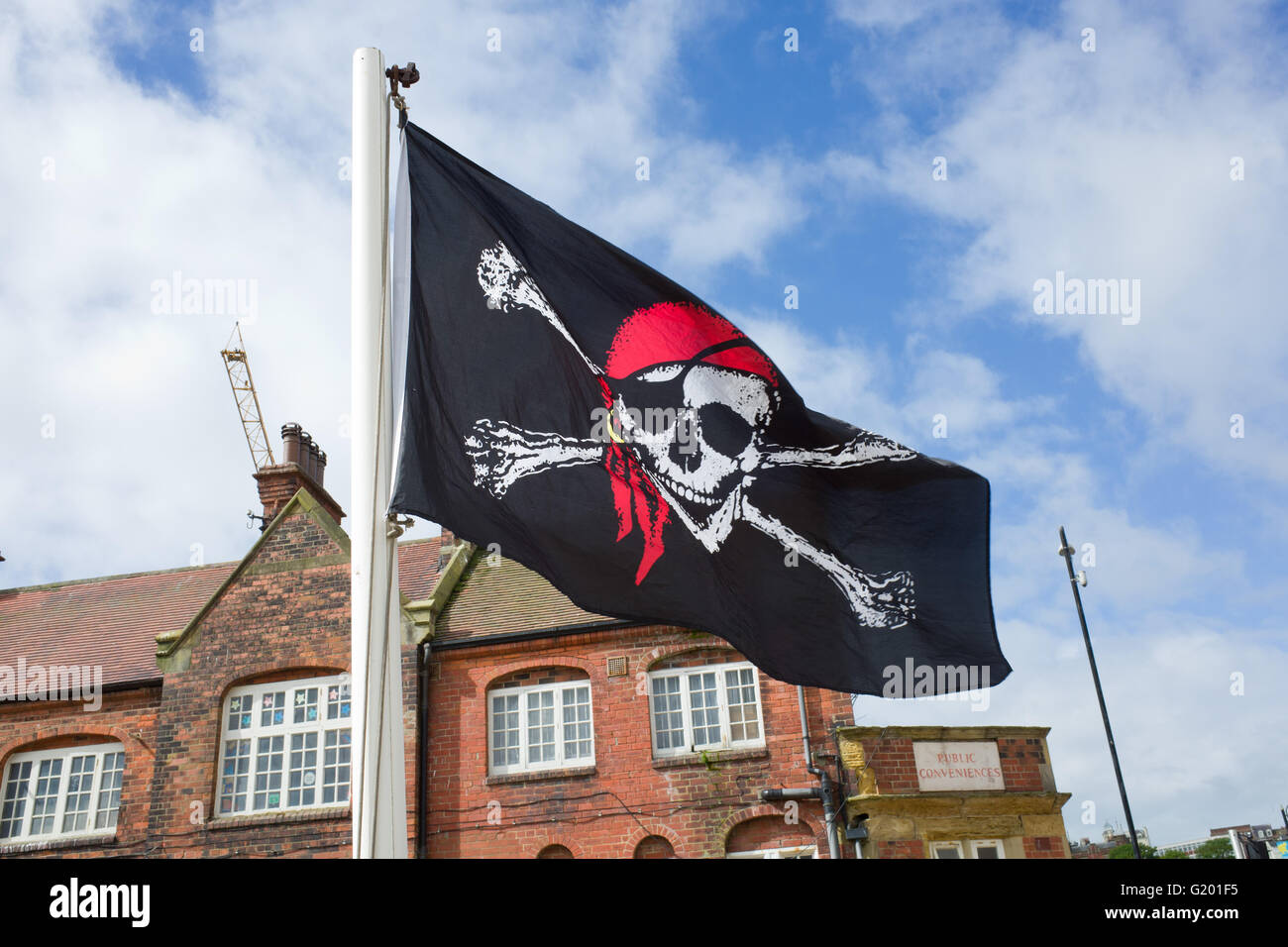 Jolly Roger Pirate Flag, Scarborough North Yorkshire UK - Stock Image