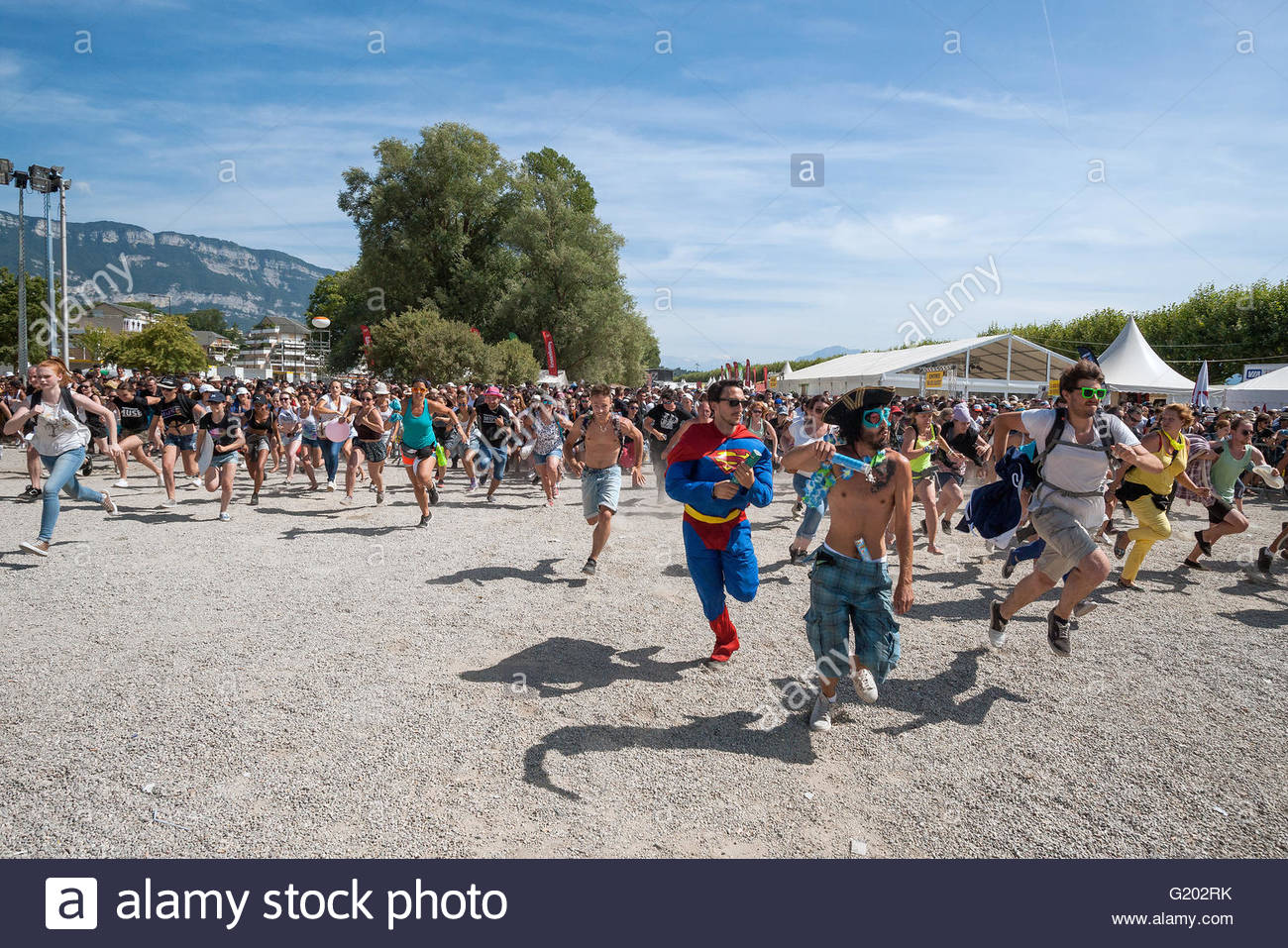 Musilac festival in Aix-les-Bains (France) - opening the gates: young peaople rushing to see their favorite bands - Stock Image