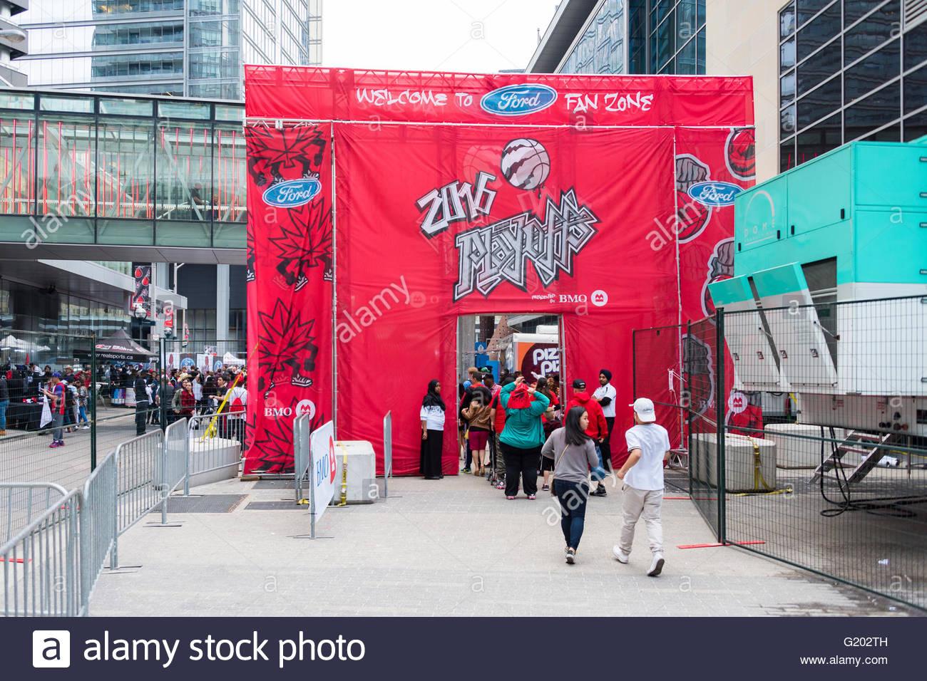 Raptors basketball team fans entering the  Ford fan zone better known as the 'Jurassic Park' fan zone. - Stock Image