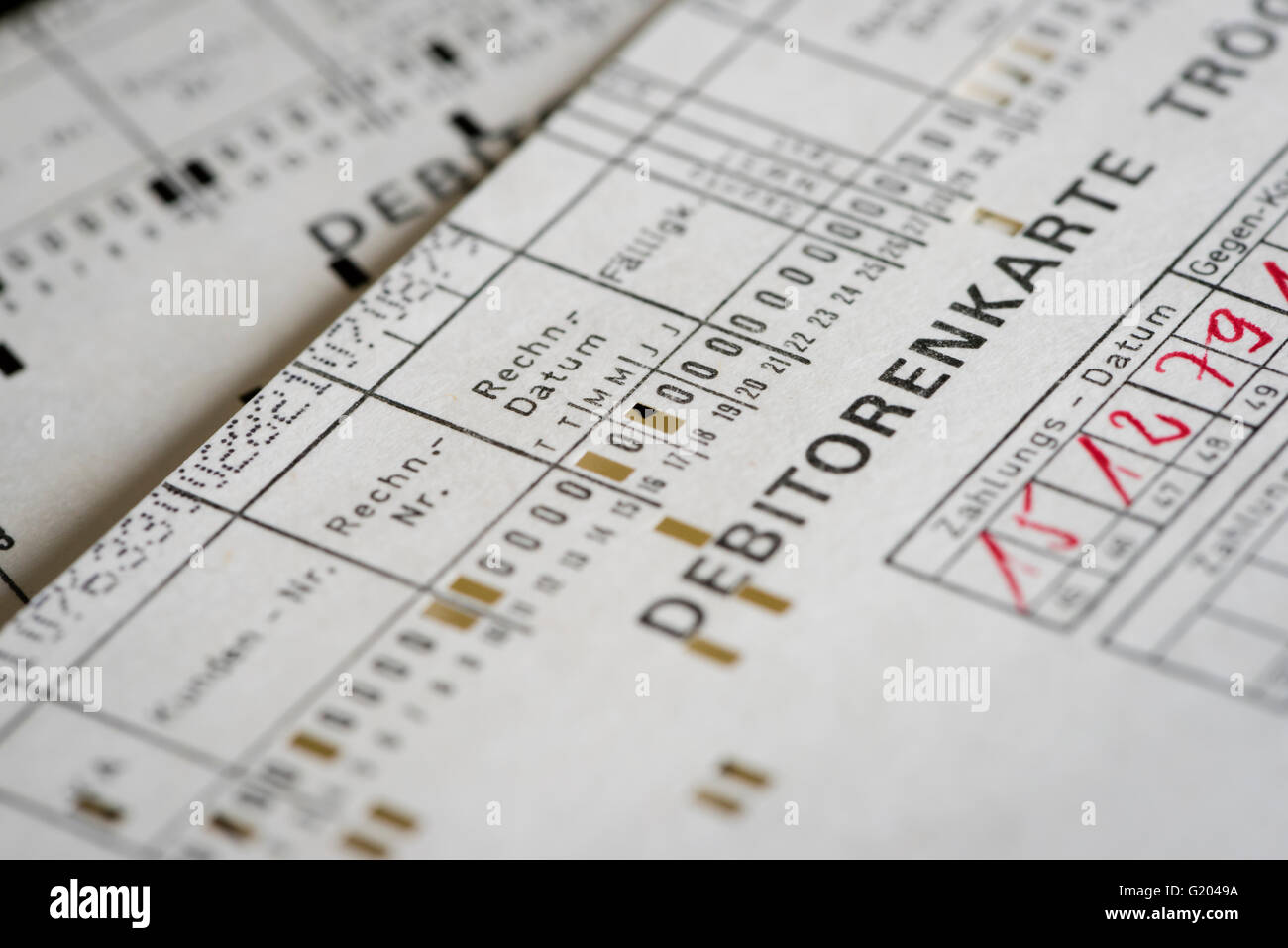 Computer punch cards used for an early computerized accounting system (running on a historic mainframe computer, - Stock Image