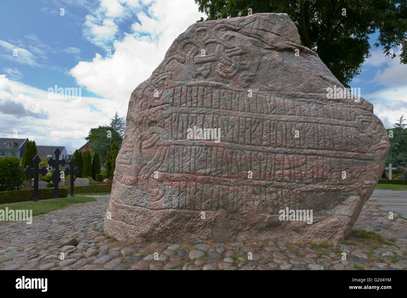 Runic inscription on the large Jelling rune stone from the 10th century raised by King Harald Bluetooth in Jelling. Stock Photo