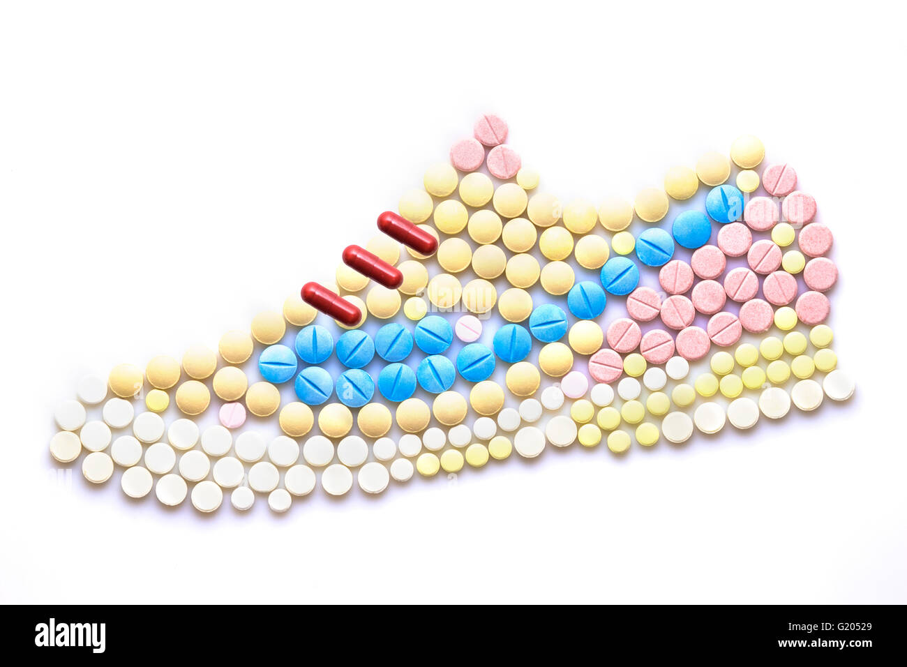 Creative medicine and health care concept made of drugs and pills, in the shape of running shoes. - Stock Image