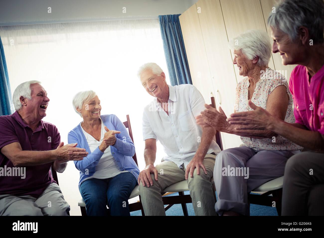 Seniors interacting Stock Photo