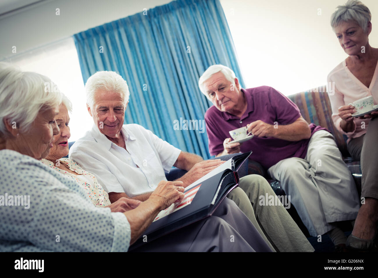 Seniors looking at pictures Stock Photo