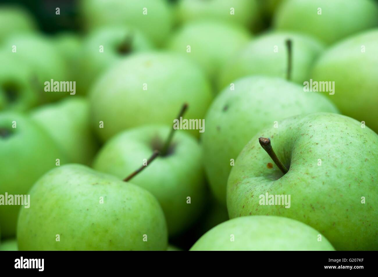 Heap of fresh green Granny Smith apples. Background image - Stock Image