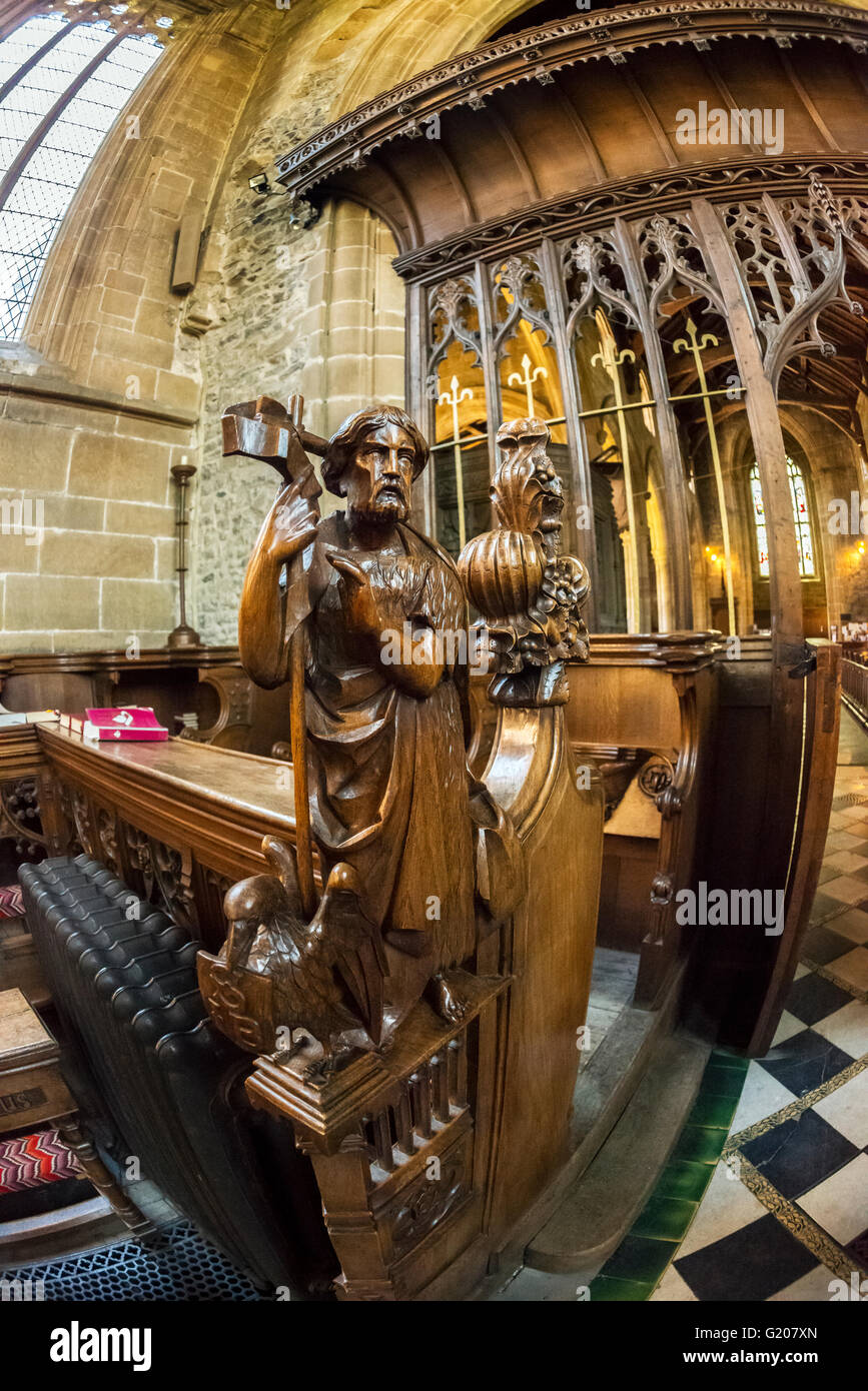Carved Pew Figure, Tideswell Parish Church, Tideswell, Derbyshire - Stock Image