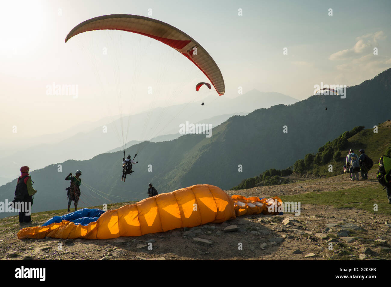 A paraglider flyer gets ready for take off at Bir Billing, Himachal Pradesh - Stock Image