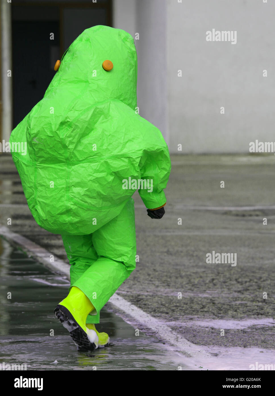 man with green protective gear against biological risk - Stock Image