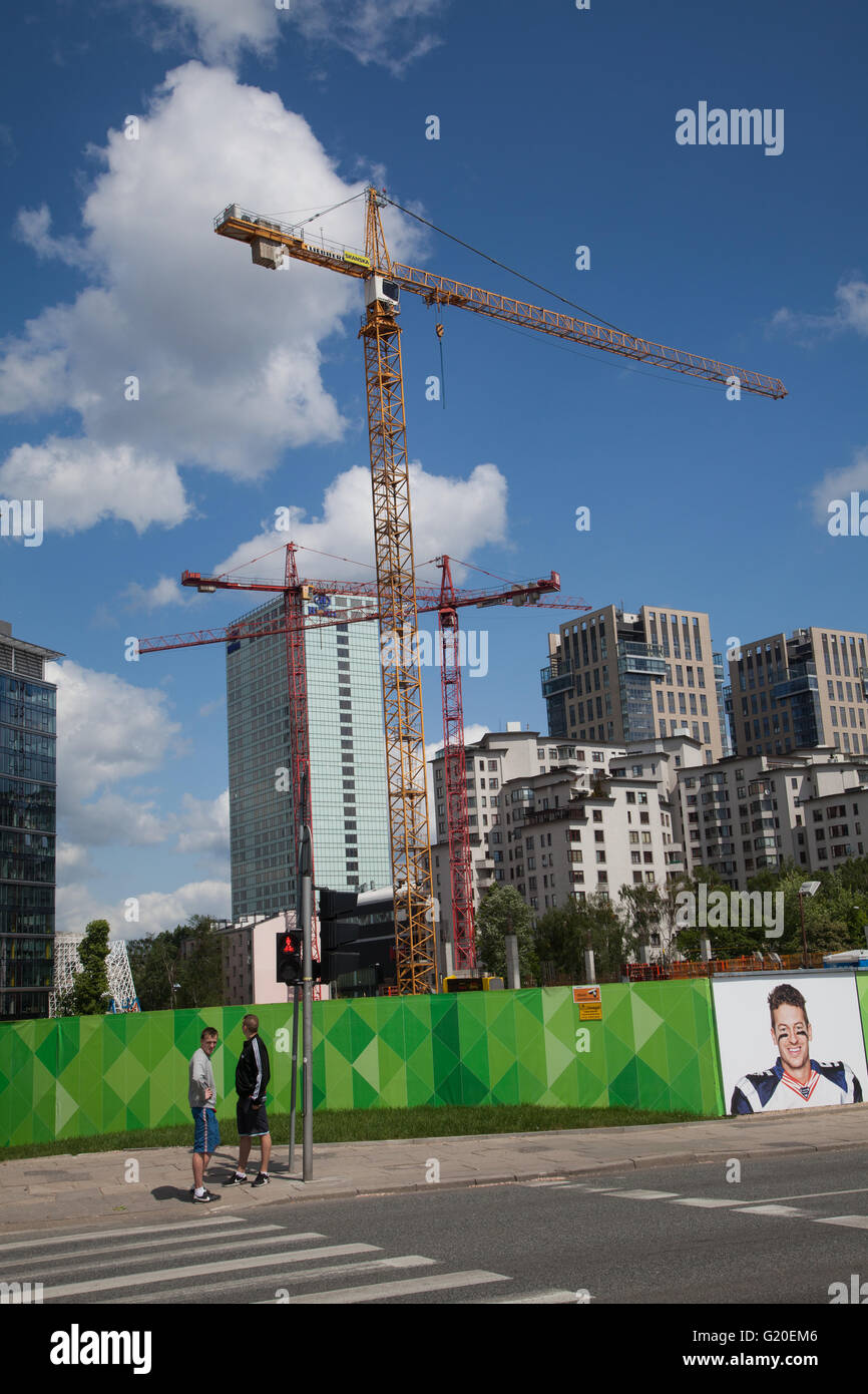 construction work with cranes in Warsaw Poland ,being watched by two men - Stock Image