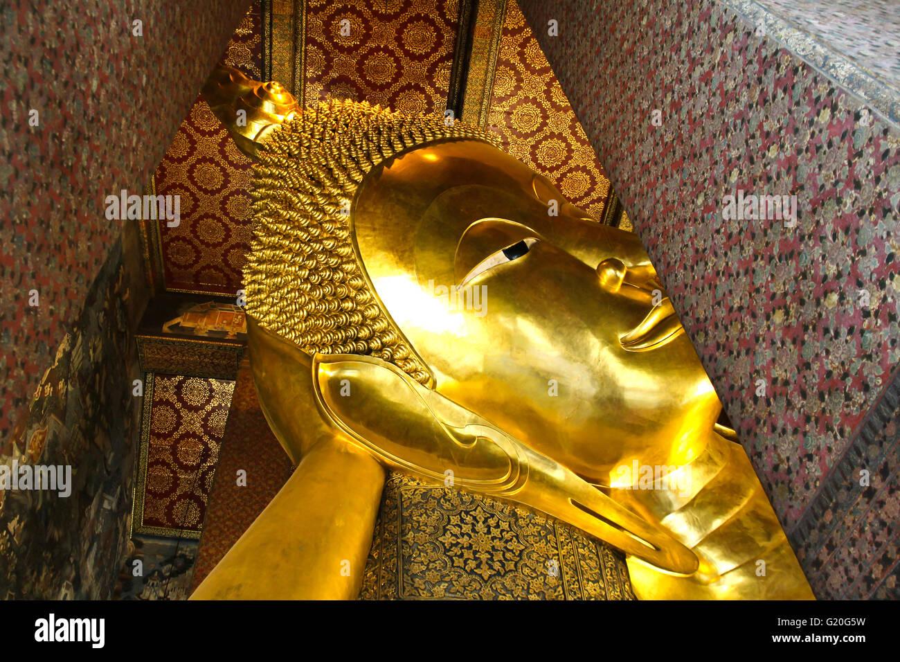 Reclining Buddha gold statue ,Wat Pho, Bangkok, Thailand. - Stock Image