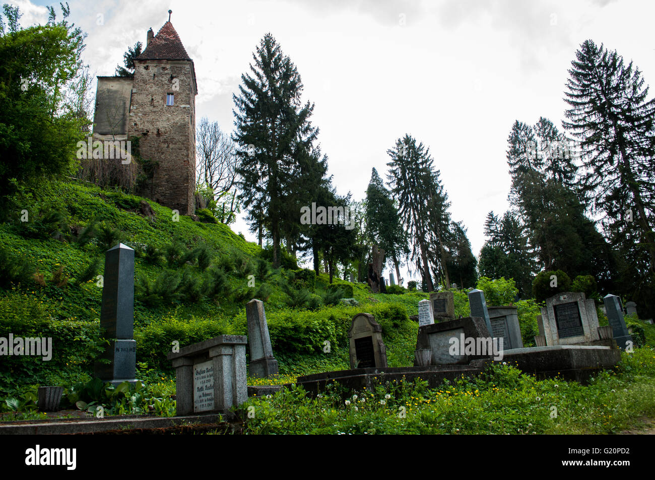 Medieval cemetery - watch-tower over old cemetery in Sighisoara, Romania - Stock Image