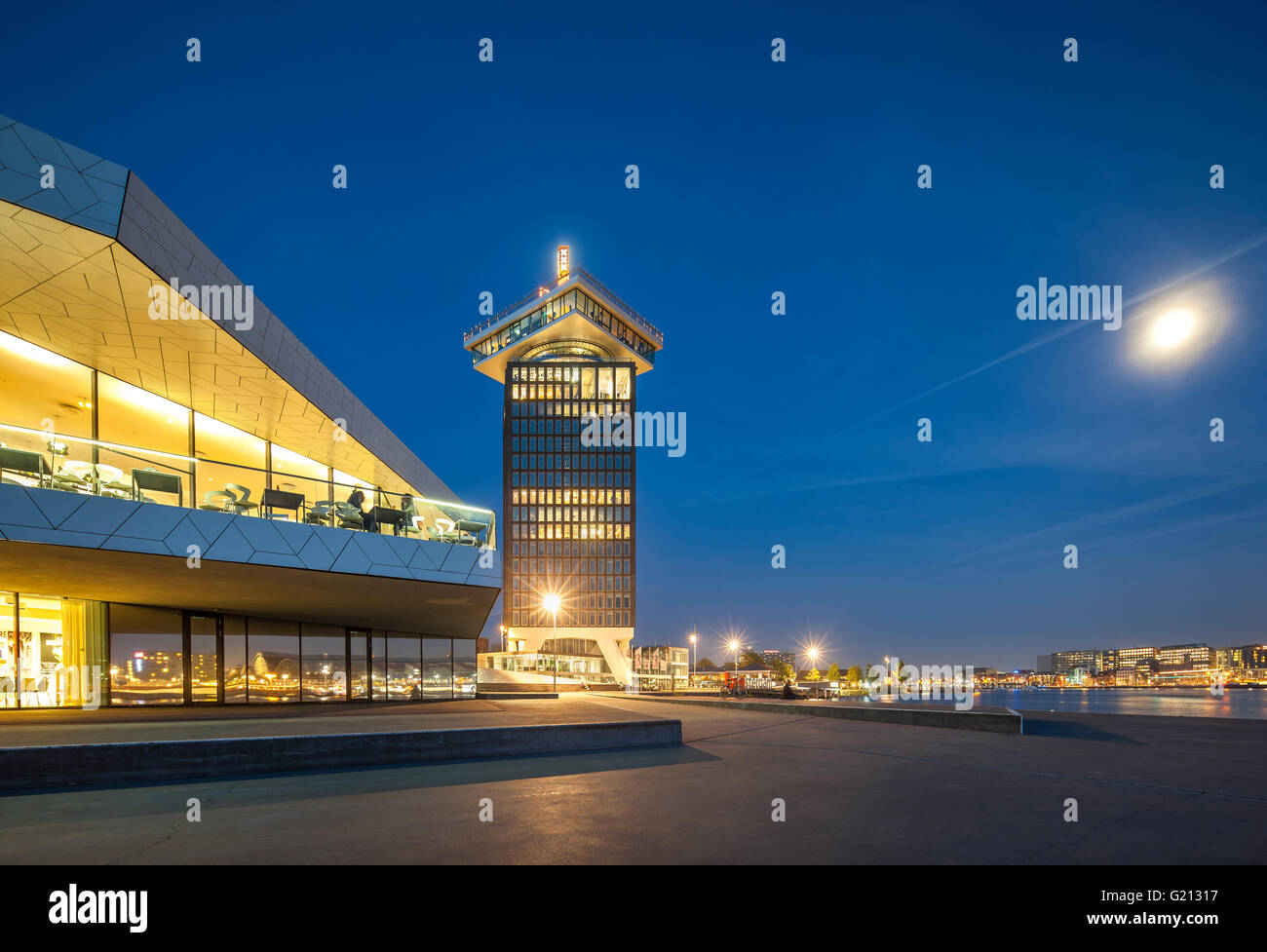 Amsterdam Adam Lookout Tower and Amsterdam EYE Film Institute building on waterfront of the IJ harbor with full - Stock Image