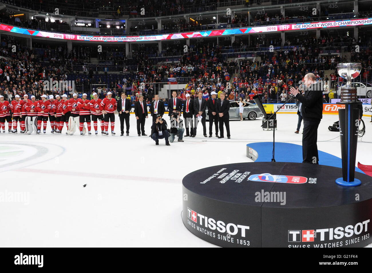 Russia's President Vladimir Putin (R) speaks during an awards ceremony following the 2016 IIHF World Championship Stock Photo