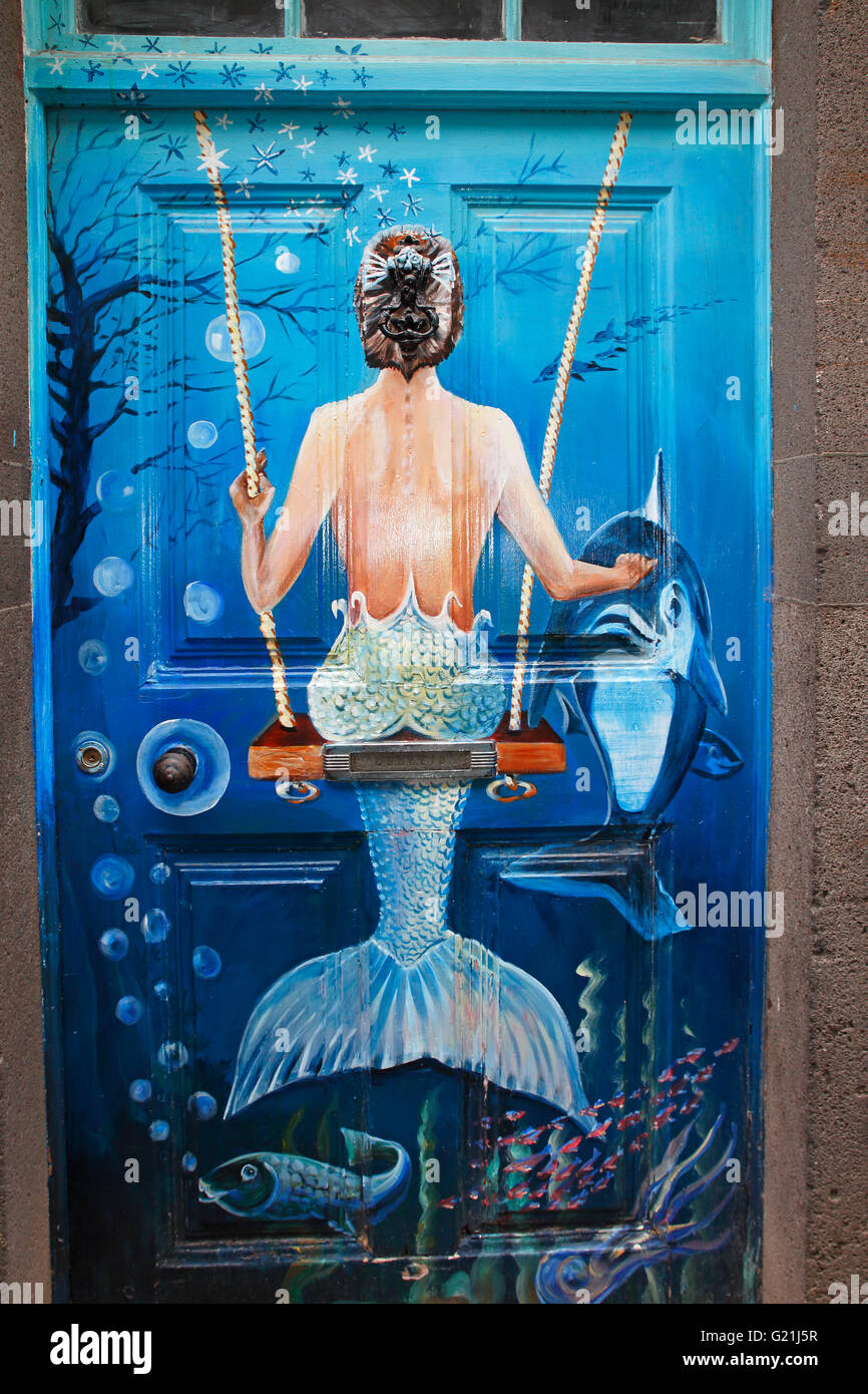 Swings Mermaid, street art, artistically painted door, historical centre of Funchal, Madeira, Portugal - Stock Image