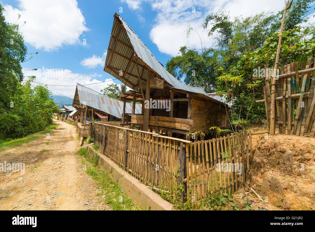 Outstanding and unique local architecture, wooden buildings with boat shaped rooftop and traditional decoration, - Stock Image