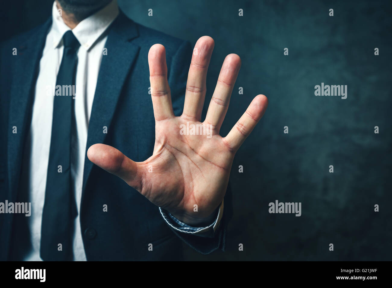 Businessman with long fingers, concept of relation between body parts and intelligence - Stock Image