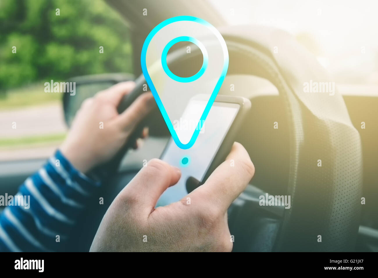 Female driving car and using gps navigation app on