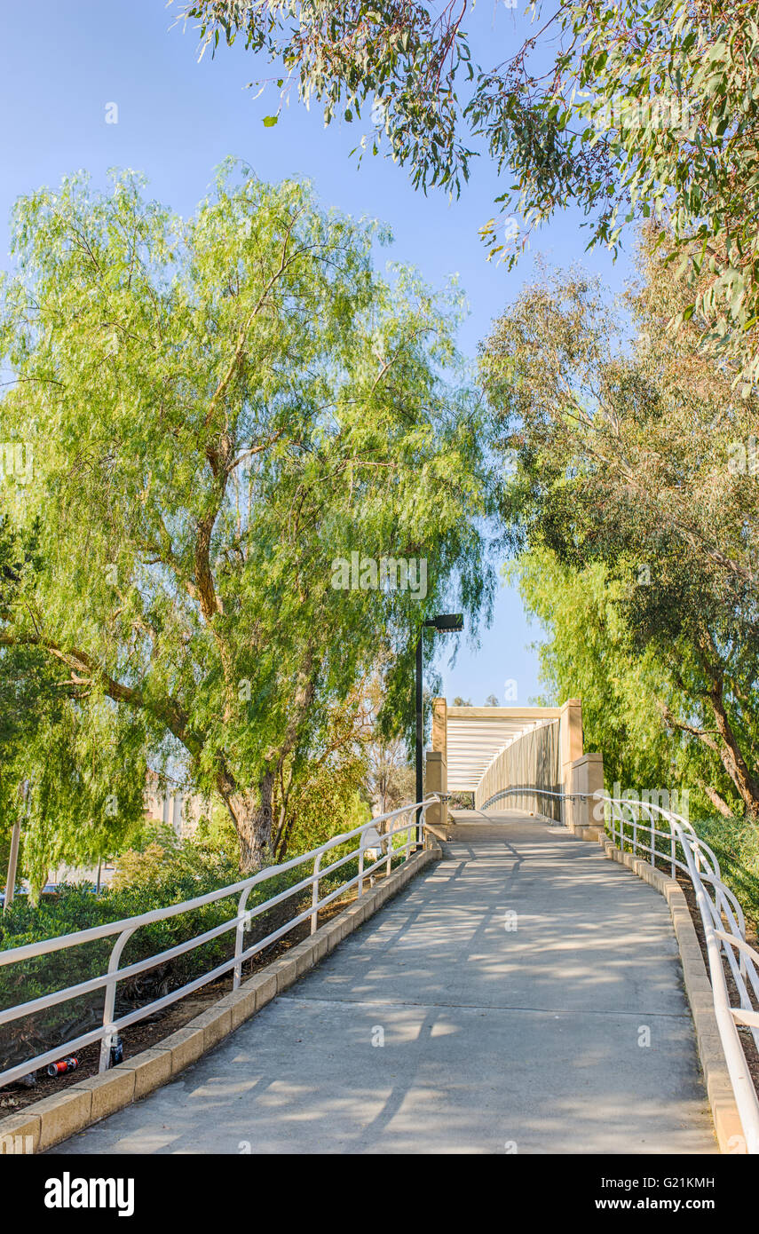 Lonely empty walking trail leads through the suburbs of Los Angeles in southern California. - Stock Image