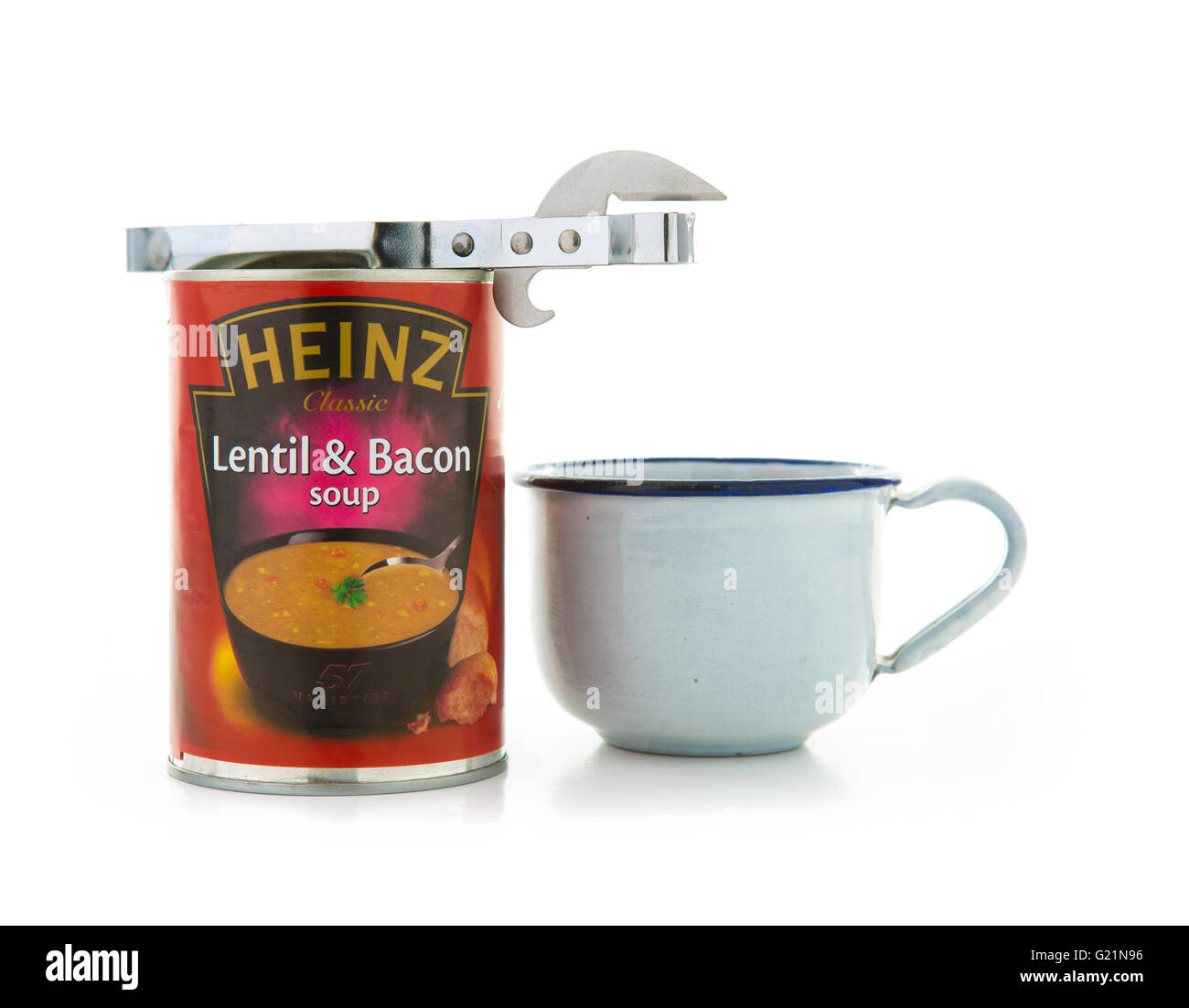 Heinz lentil and Bacon soup with a tin opener and cup on a white background - Stock Image