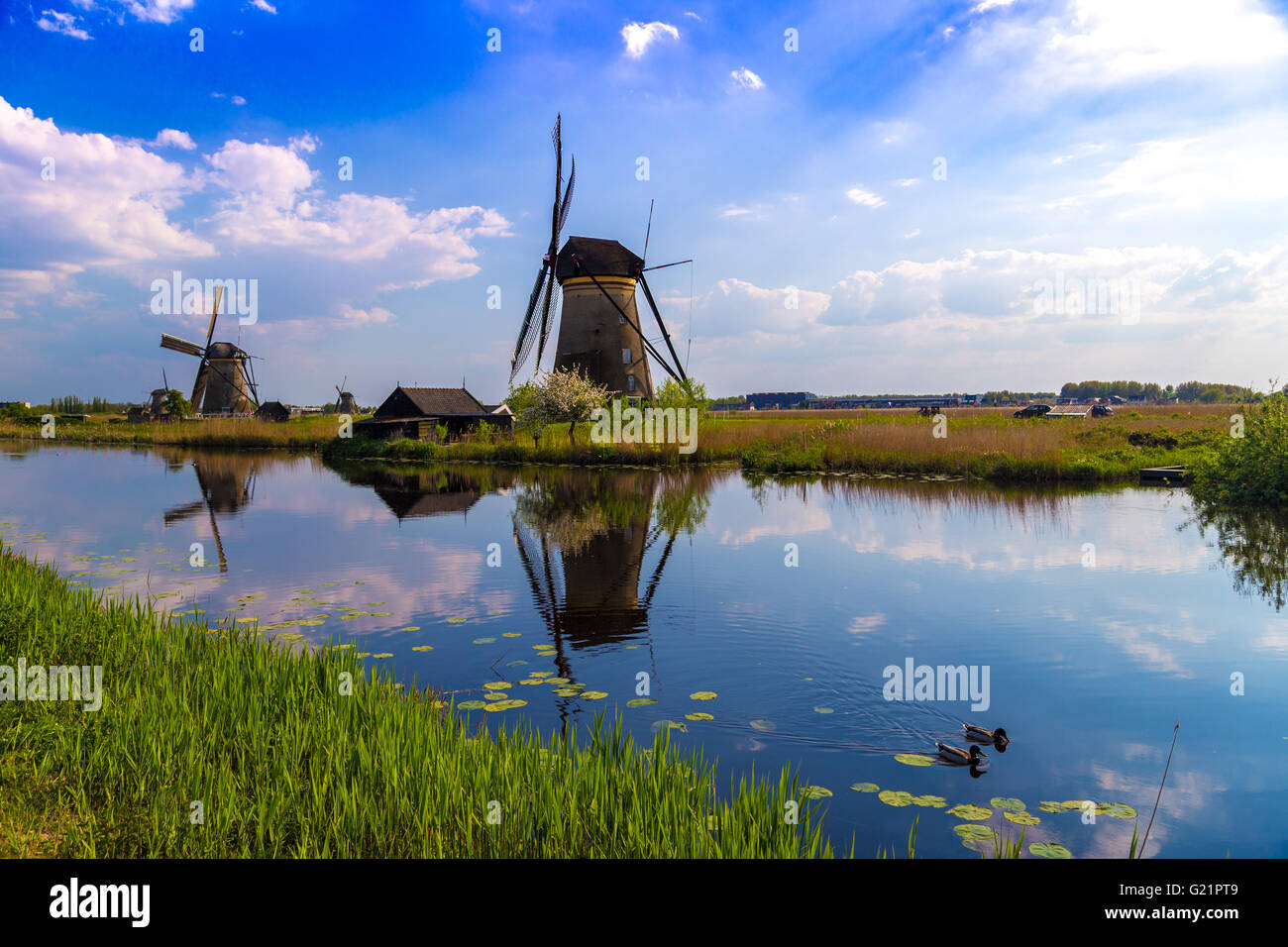 Windmills reflected in the Dutch canals at Kinderdijk, UNESCO site in the Netherlands Stock Photo