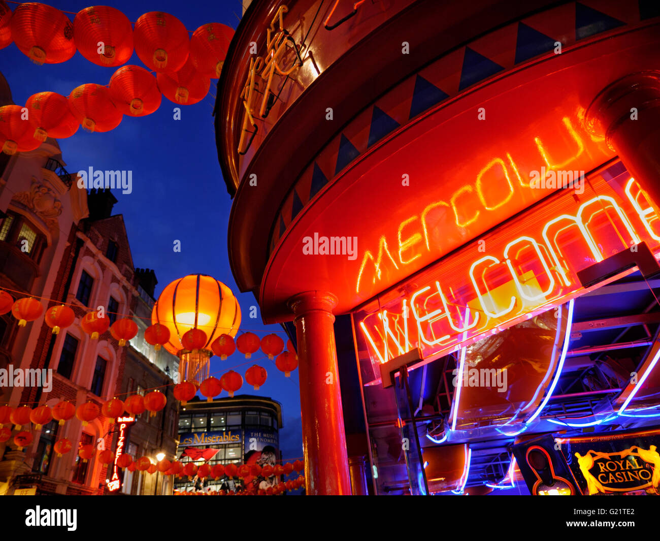CHINATOWN WELCOME SOHO LONDON NIGHT Chinese lanterns lit up on a busy night in Wardour Street with neon 'Welcome' - Stock Image