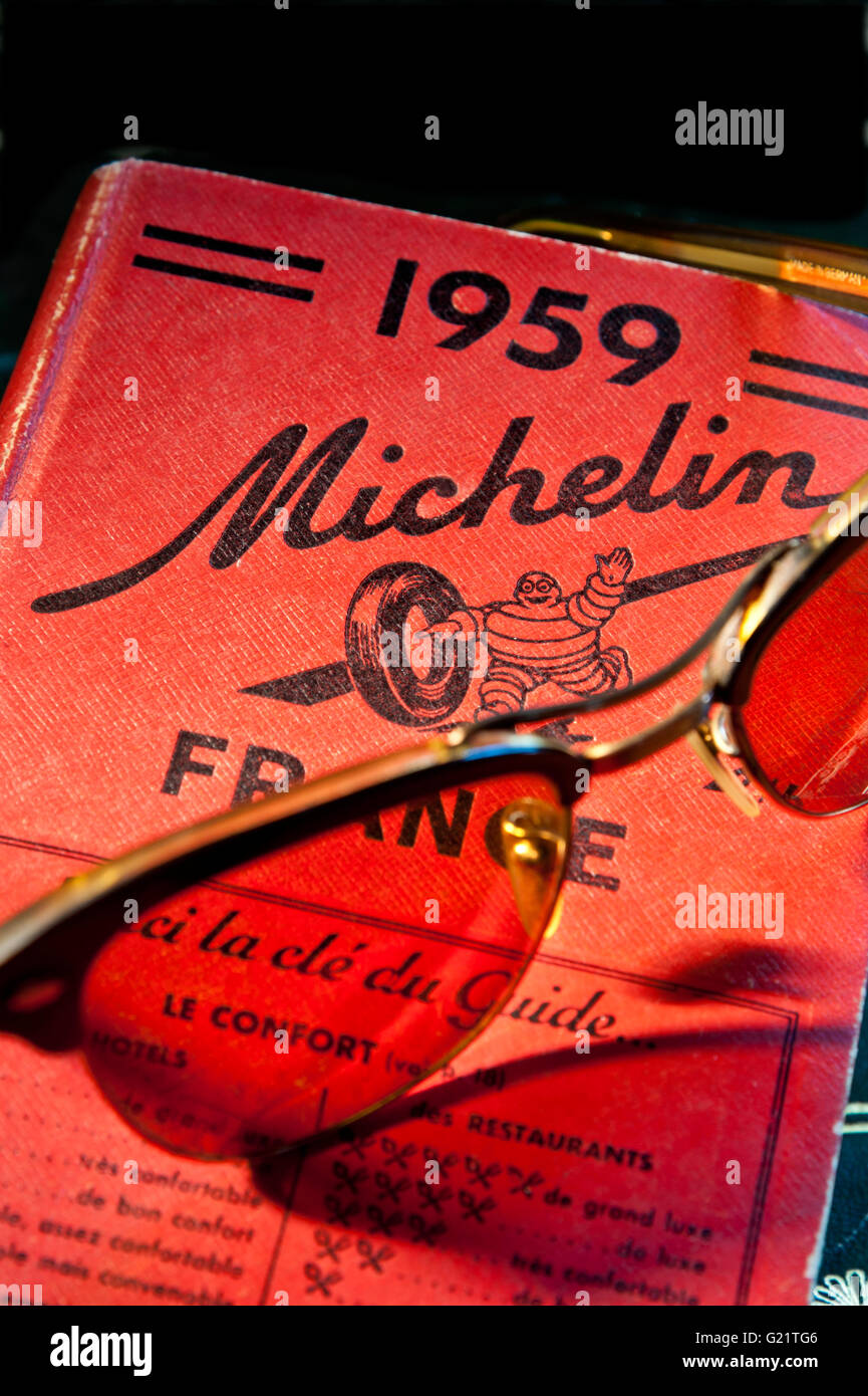 Vintage retro Zeiss sunglasses on 1959 Michelin travel guide book on France - Stock Image