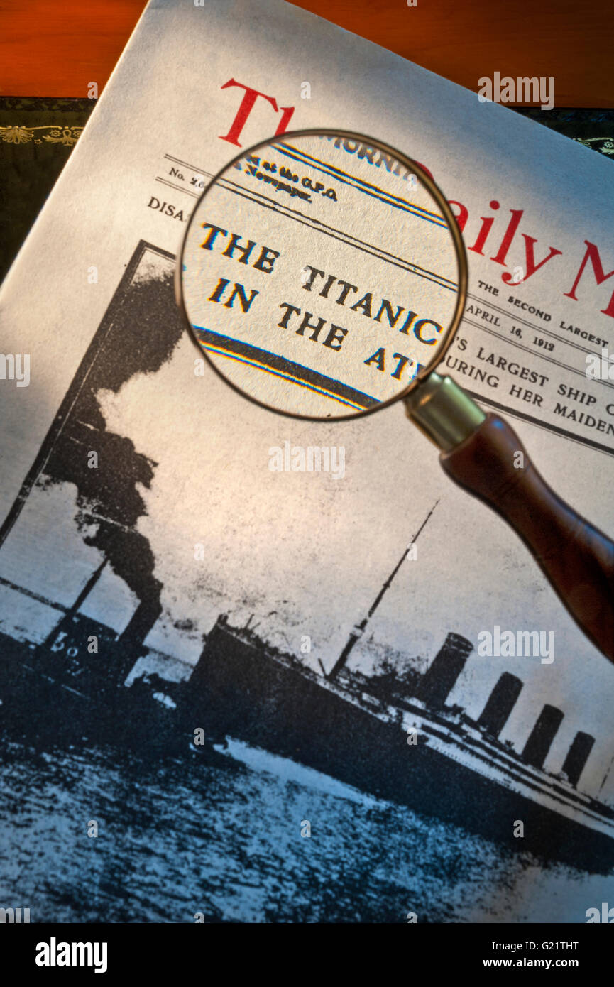 Front page of Daily Mirror dated April 16th 1912 with headline on Titanic disaster with magnifying glass viewing - Stock Image