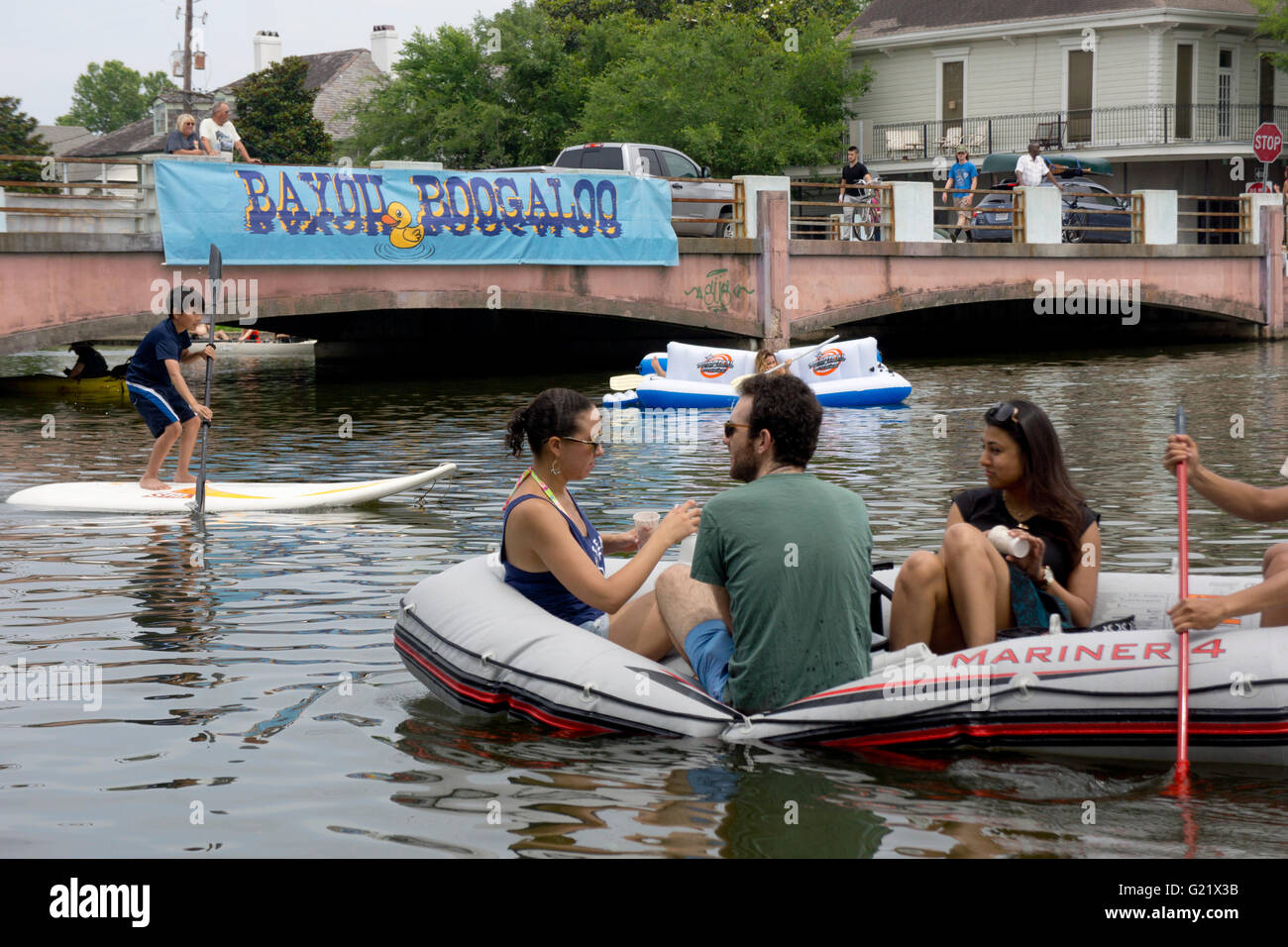 Paddle-boarding and rafting on the water at the Bayou Boogaloo festival in New Orleans. - Stock Image