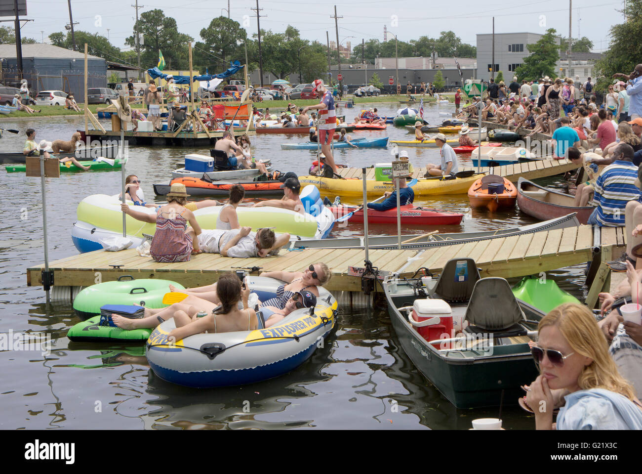 Hundreds of people along the banks of Bayou St John during the Bayou Boogaloo festival. - Stock Image