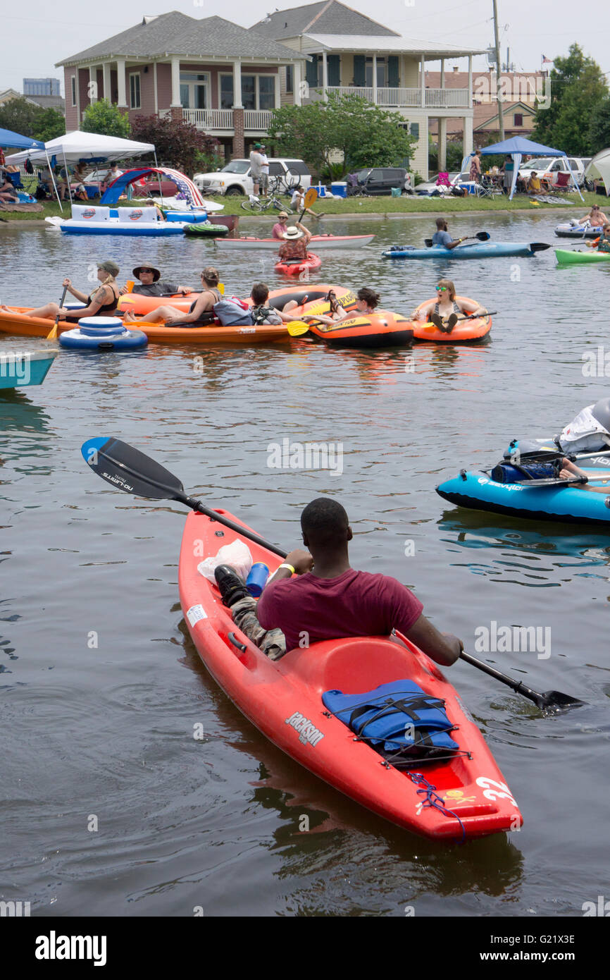 Kayakers out on Bayou St. John during the Boogaloo Festival. - Stock Image