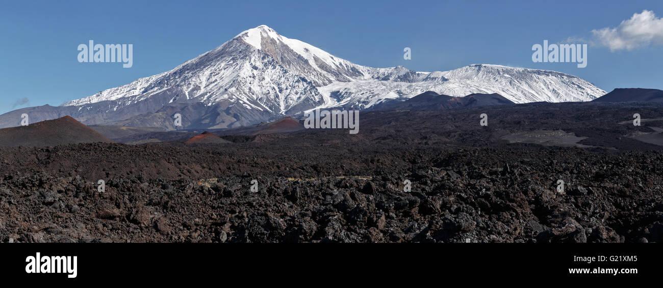 Beautiful volcanic landscape of Kamchatka: panoramic view on lava field active Tolbachik Volcano. Russia, Kamchatka - Stock Image