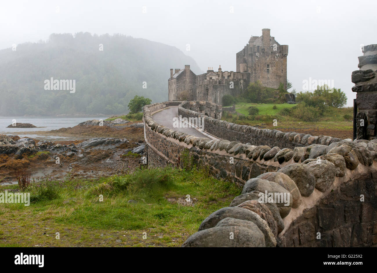Famous Eilean Donan Castle at  loch Alsh lake in the Highlands of Scotland - Stock Image