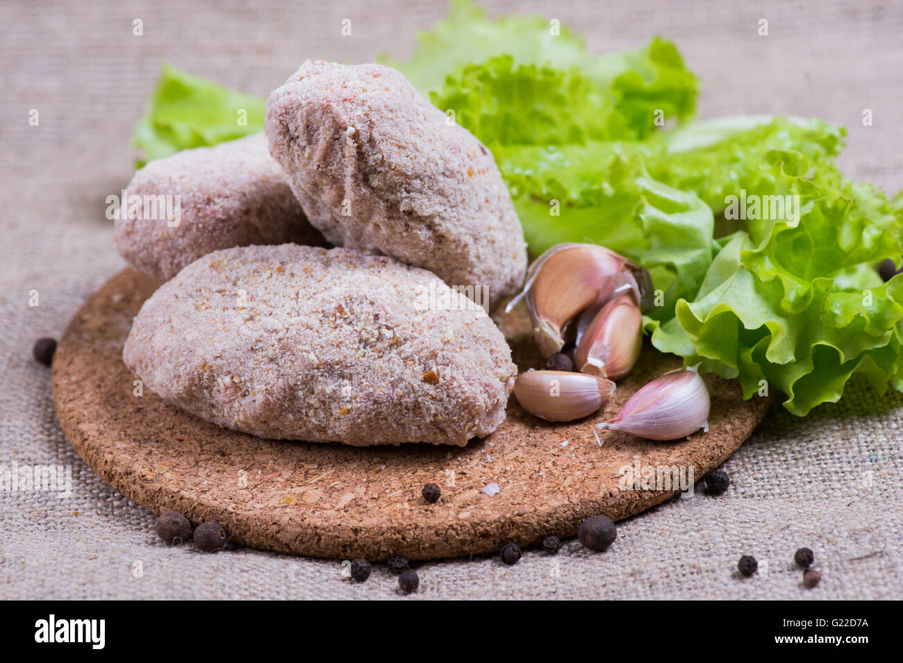 fresh raw cutlet with herbs and tomatoes, mushrooms, pepper - Stock Image