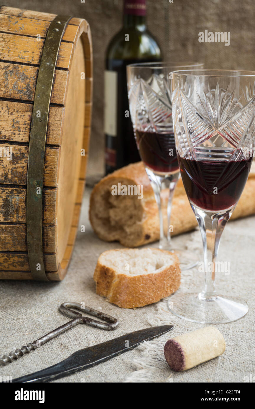 Octave, wineglass, bread are on sacking - Stock Image