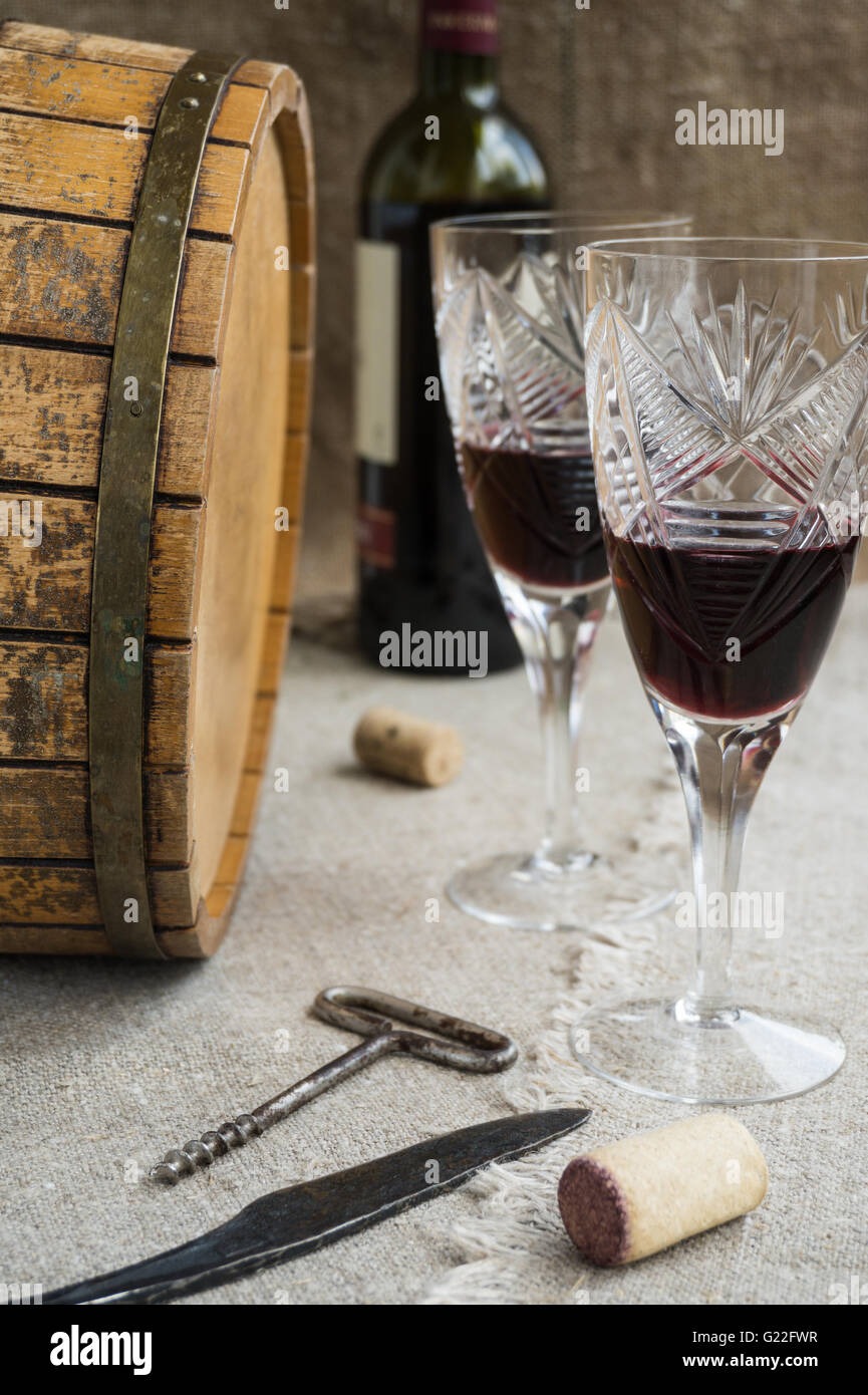 Octave, wineglass, knife, corkscrew are on sacking - Stock Image