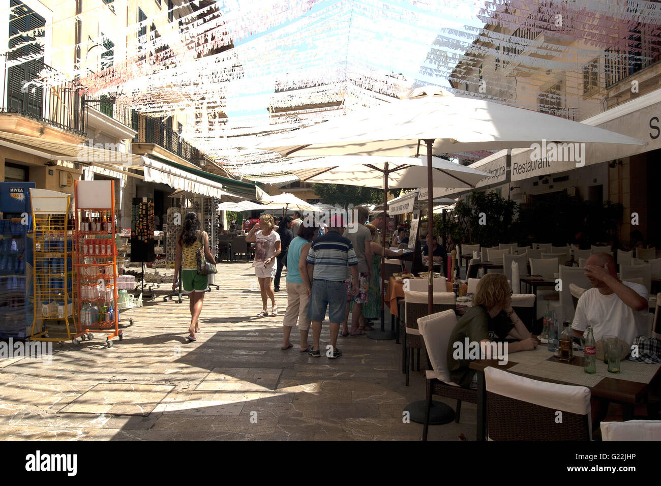 a beautiful photo of a busy touristy street with cafés and souvenir shops in Palma de Mallorca, Spain, seaside, - Stock Image