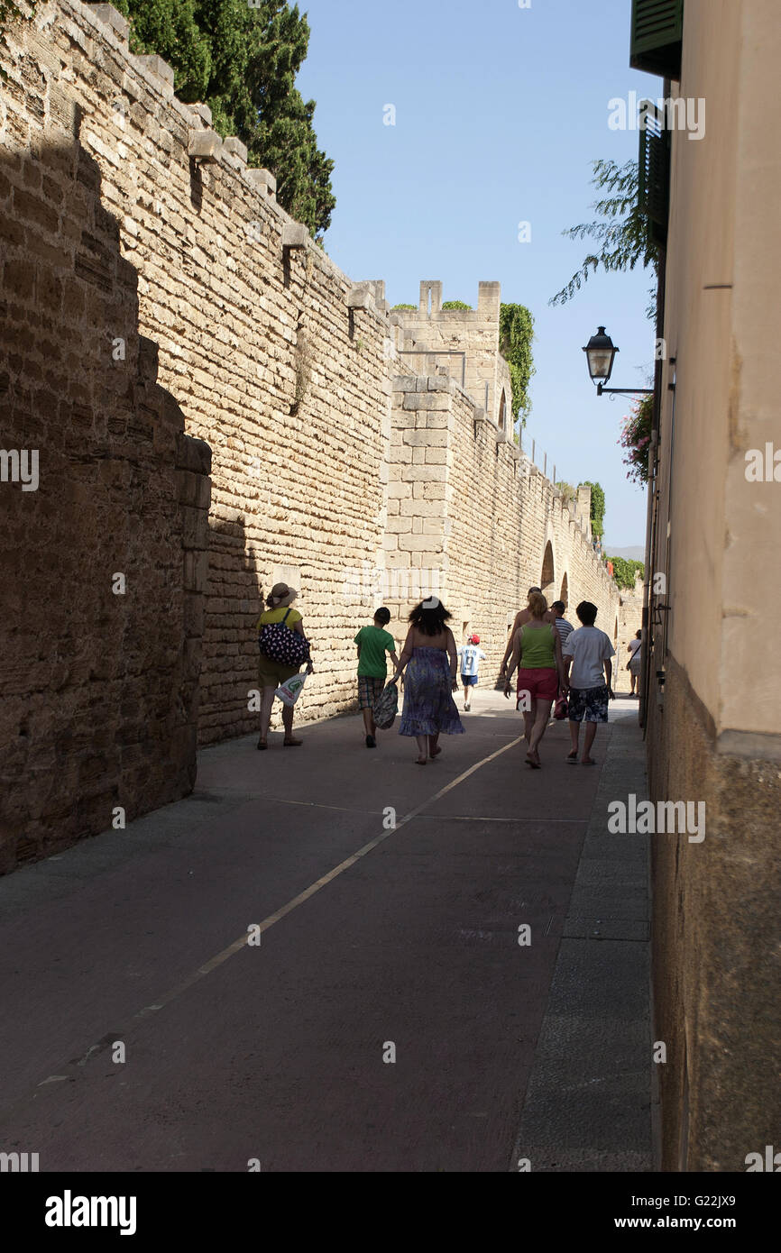 a beautiful photo of a quiet road in the shade with an ancient fortress wall, Palma de Mallorca, Spain, seaside, - Stock Image