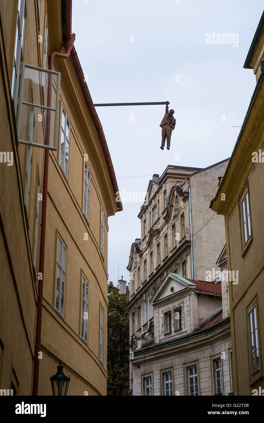 'Man hanging out' sculpture, by David Cerny. Prague, Czech Republic. The sculpture hangs high above the - Stock Image