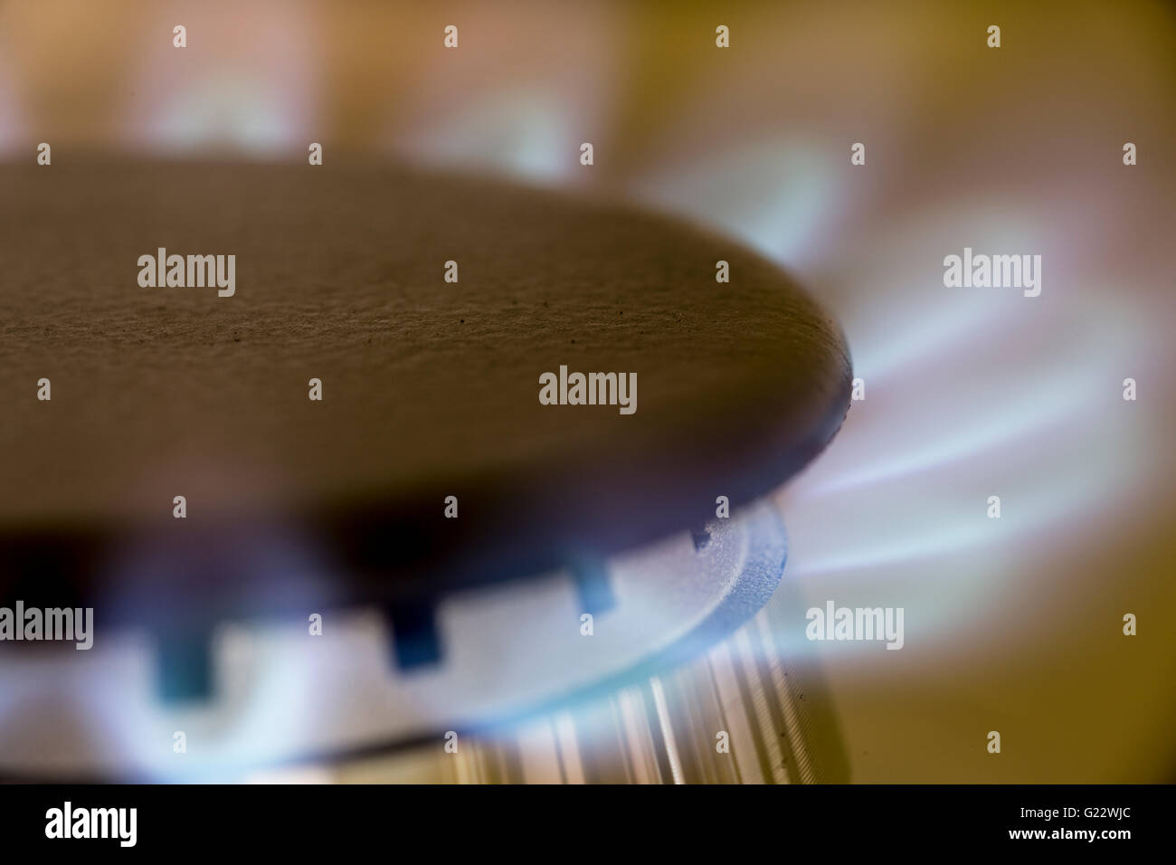 Close up of gas flame on gas hob - Stock Image