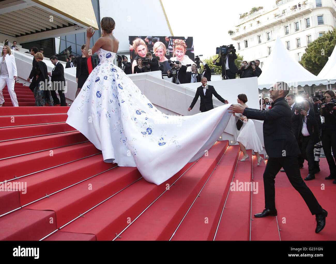 Model Jourdan Dunn has her dress adjusted upon arrival at the screening of the film La Fille Inconnue (The Unkown - Stock Image