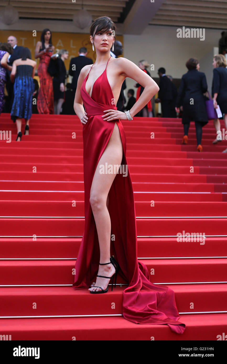 Model Bella Hadid poses for photographers upon arrival at the screening of the film La Fille Inconnue (The Unkown - Stock Image