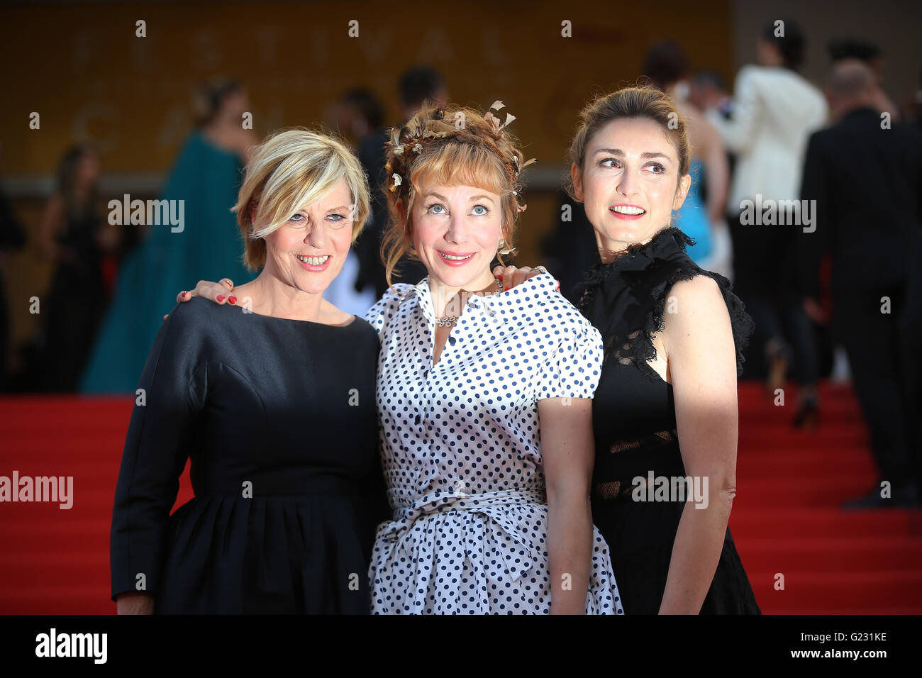Actresses Chantal Ladesou, from left, Julie Depardieu and Julie Gayet pose for photographers upon arrival at the - Stock Image