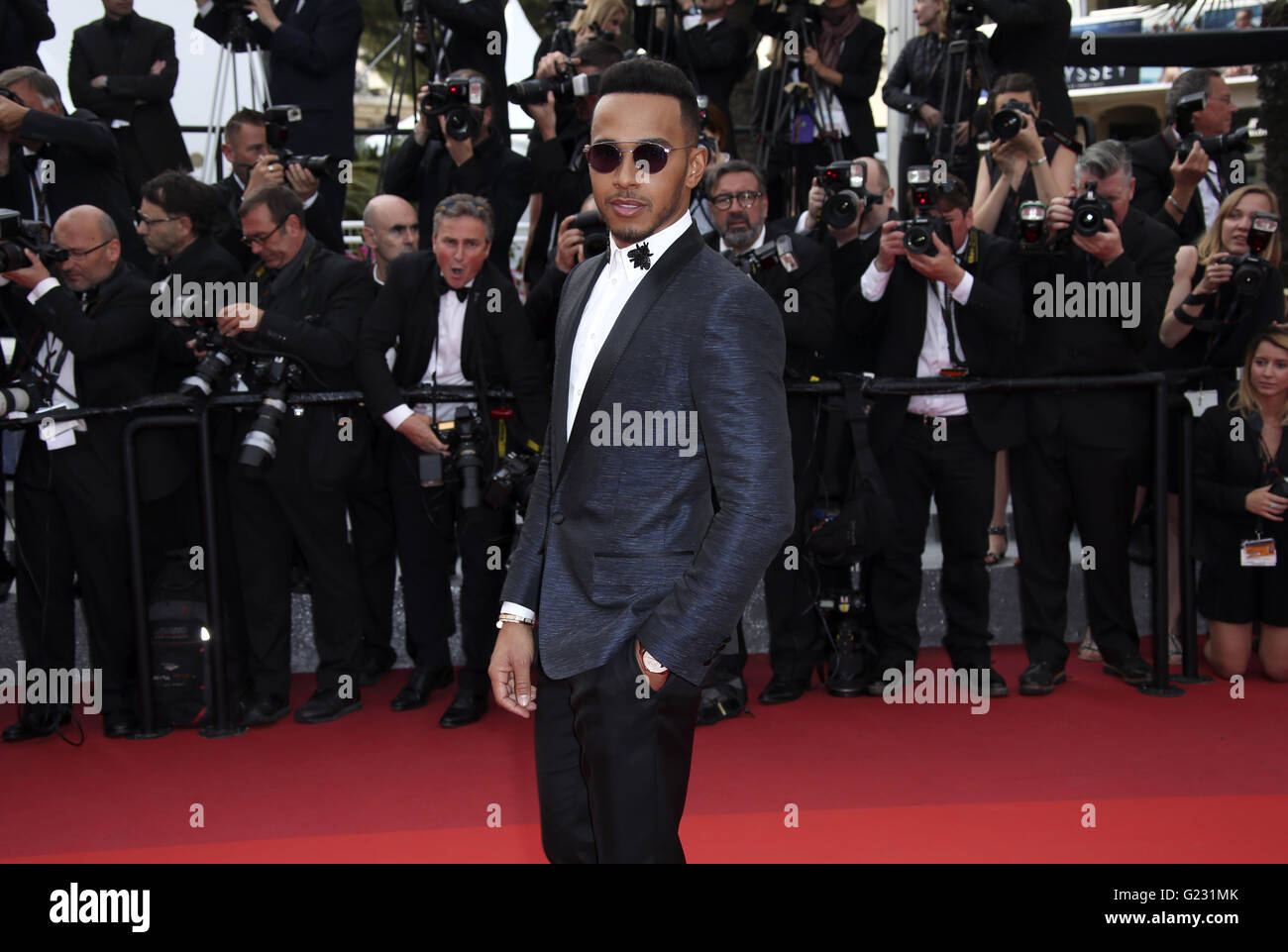 Lewis Hamilton poses for photographers upon arrival at the screening of the film La Fille Inconnue (The Unkown Girl) - Stock Image