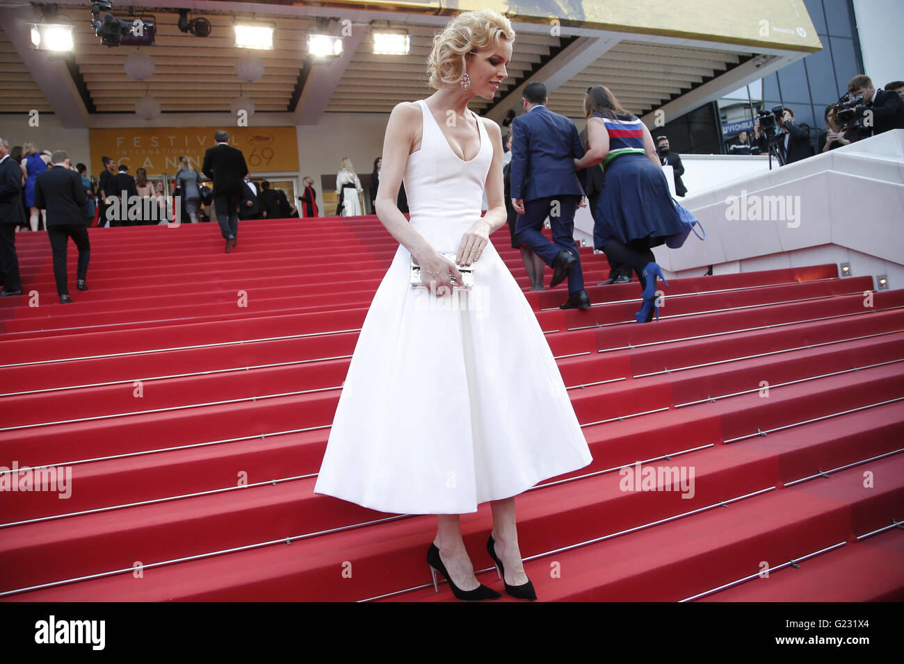 Model Eva Herzigova pose for photographers upon arrival at the screening of the film La Fille Inconnue (The Unkown - Stock Image