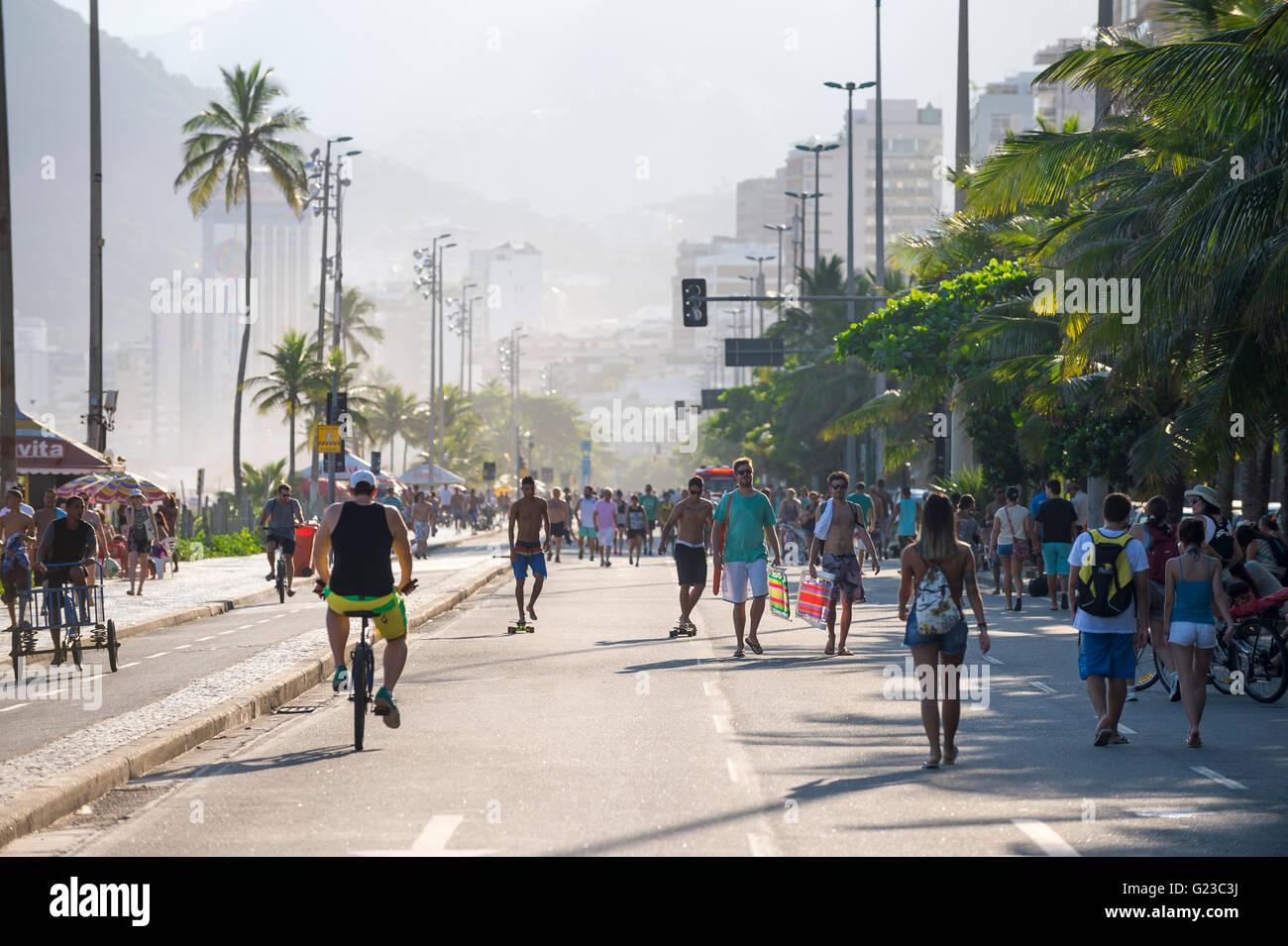 RIO DE JANEIRO - MARCH 6, 2016: Cyclists share the car-free Avenida Vieira Souto street with pedestrians at Ipanema - Stock Image
