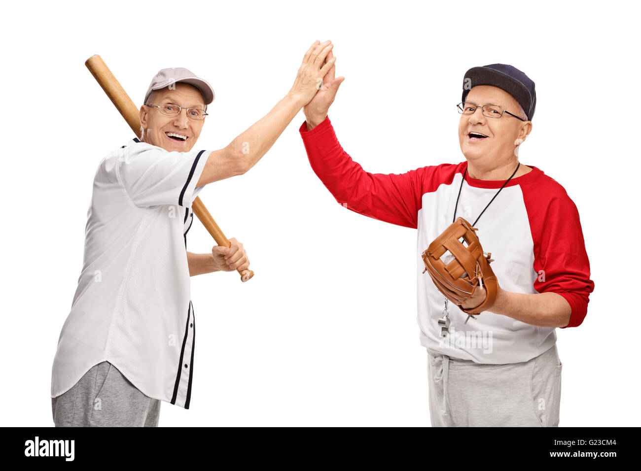 Two seniors in baseball sportswear high-five each other isolated on white background - Stock Image