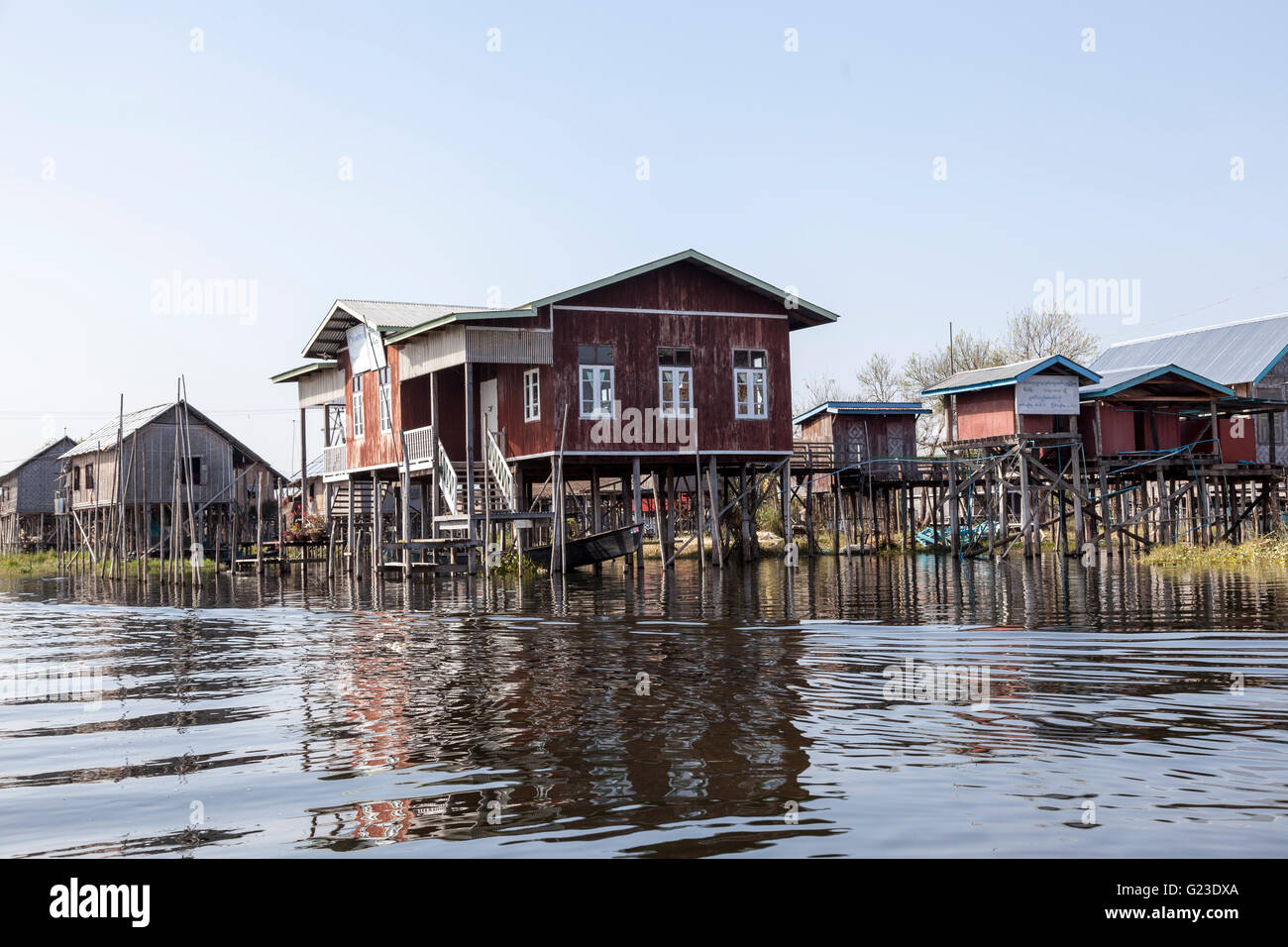Light and on top of their stilts, the Inle Lake houses surprise visitors by the variety of their shapes and colours - Stock Image