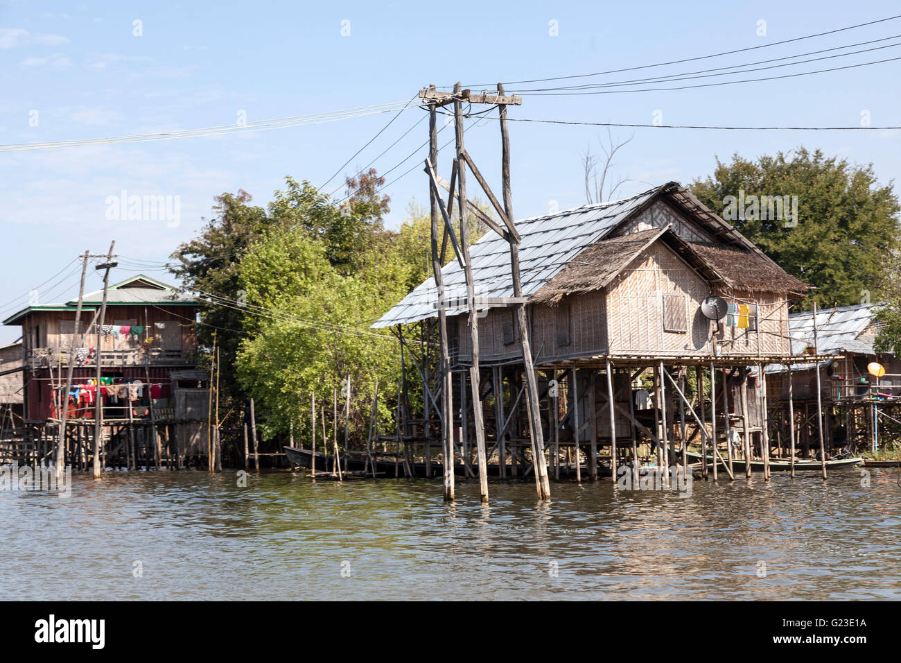 Light and on top of their stilts, the Inle Lake houses surprise by the variety of their shapes and colours (Myanmar). - Stock Image